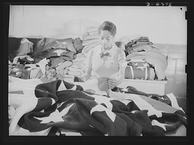 Women workers at quartermaster depot. The tradition of Betsy Ross is being kept alive in this quatermaster corps depot where this young woman worker assists in the creation of American flags for military activitities. Philadelphia Quartermaster Corps