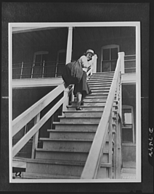 Women's Army Auxiliary Corps. Lorraine Stuteman of San Antonio, Texas, is shown carrying her barrack bag, which is filled with newly issued WAAC clothing, to her quarters. Fort Des Moines, Iowa
