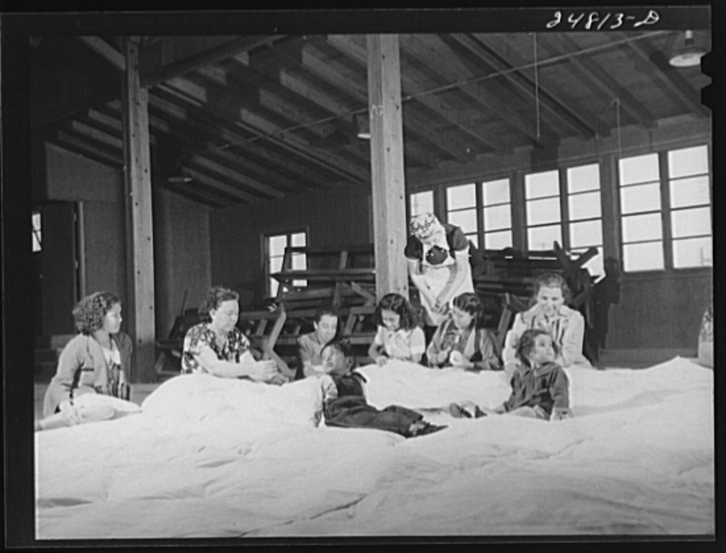 Women's committee works on mat for athletics. FSA (Farm Security Administration) camp, Robstown, Texas