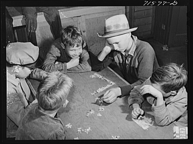 Woodville, California. FSA (Farm Security Administration) farm workers' community. Games are played in the recreation room in the community building