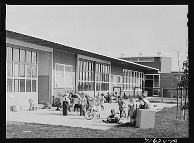 Woodville, California. FSA (Farm Security Administration) farm workers' community. Children of the nursery school playing. The nursery school uses two rooms of the central community building