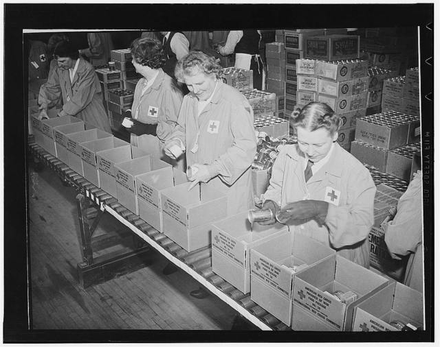 Working in daily squads of eighty, Red Cross women volunteers from all walks of life, can pack parcels at the rate of 2,000 an hour. The packages are destined for American and other Allied soldiers and sailors held in enemy prison camps