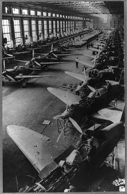 """""""Yak"""" fighter planes, for the Red air force, on the assembly lines at a Soviet factory somewhere in the USSR, March 1942"""