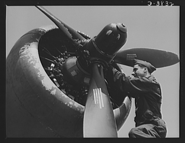 YB-17 bombardment squadron, Langley Field, Virginia. A propeller governor is adjsuted by a sergeant of a bombardment squadron at Langley Field, Virginia as part of the job of tuning up a mighty YB-17 bomber before it goes into the air