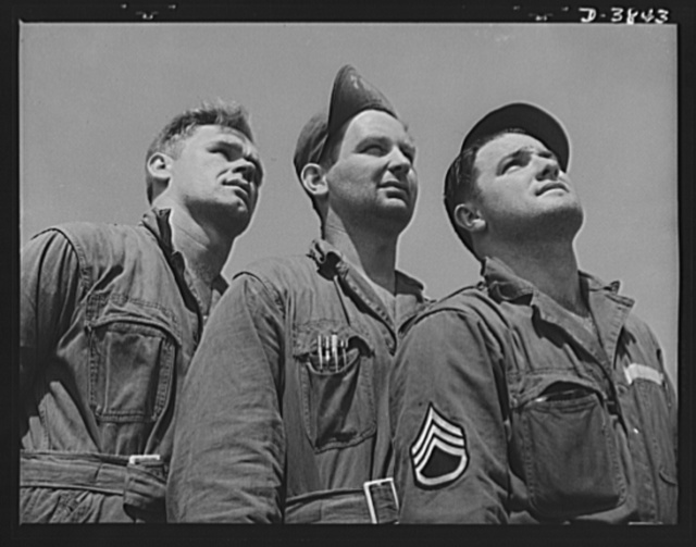 YB-17 bombardment squadron, Langley Field, Virginia. Skilled soldier-mechanics make up the gorund crew personnel of a bombardment squadron stationed at Langley Field, Virginia. These men keep ships like the fast YB-17 bombers in the pink of condition