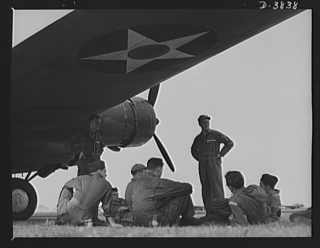 YB-17 bombardment squadron, Langley Field, Virginia. Skilled soldier-mechanics make up the ground crew personnel of a bombardment squadron stationed at Langley Field, Virginia. These men keep ships like the fast YB-17 bombers in the pink of condition