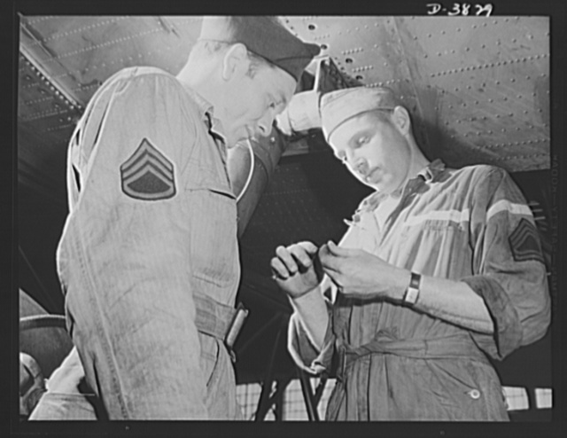 YB-17 bombardment squadron, Langley Field, Virginia. The soldier-mechanics who serve as guard crews in the Army Air Forces are skilled men. A staff sergeant and a master sergeant caliper a screw that wil be used to fasten a plate on a gas tank