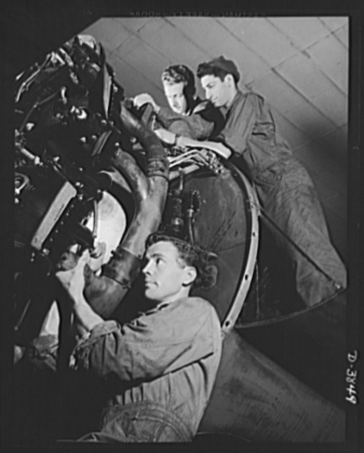 YB-17 bombardment squadron, Langley Field, Virginia. These corporals of a bombardment squadron at Langley Field, Virginia replace the exhaust pipe of a huge YB-17 bomber motor. A short time before, they had removed and inspected the pipe as part of a general engine overhaul