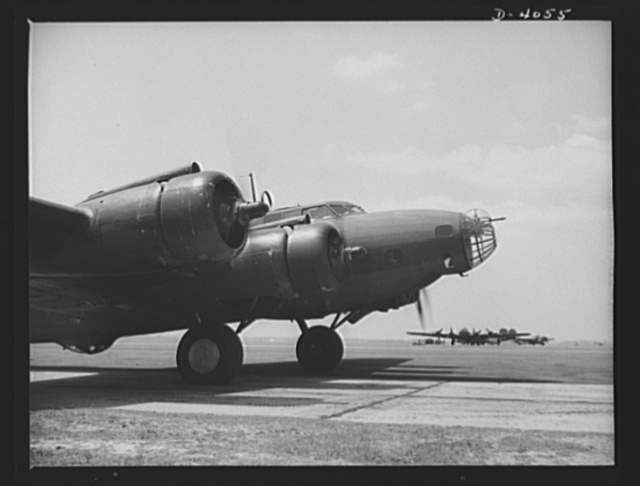 YB-17 bombardment squadron, Langley, Virginia. A mighty YB-17 four-engine bomber taxiing down a runway at Langley, Virginia, just before taking off on a mission