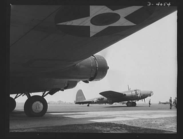 YB-17 bombardment squadron, Langley, Virginia. The profile of a YB-17 bomber as seen from beneath the wing of another plane of the same type. These powerful four-engined ships belong to a bombardment squadron at Langley, Virginia