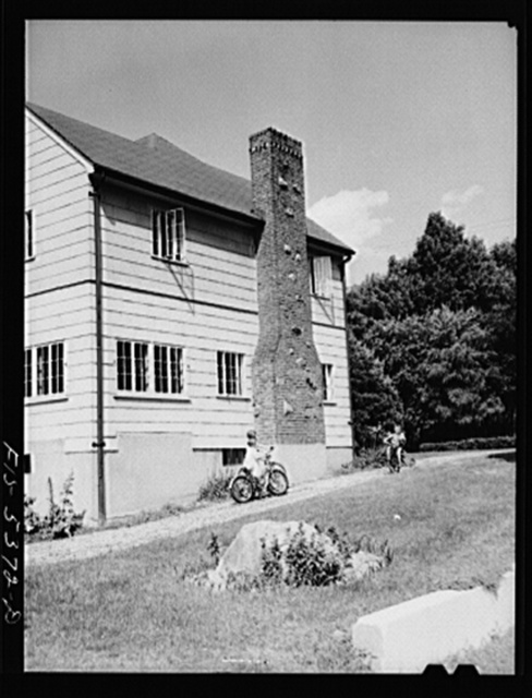 Yonkers, New York. The Garrity children playing in the driveway of their home