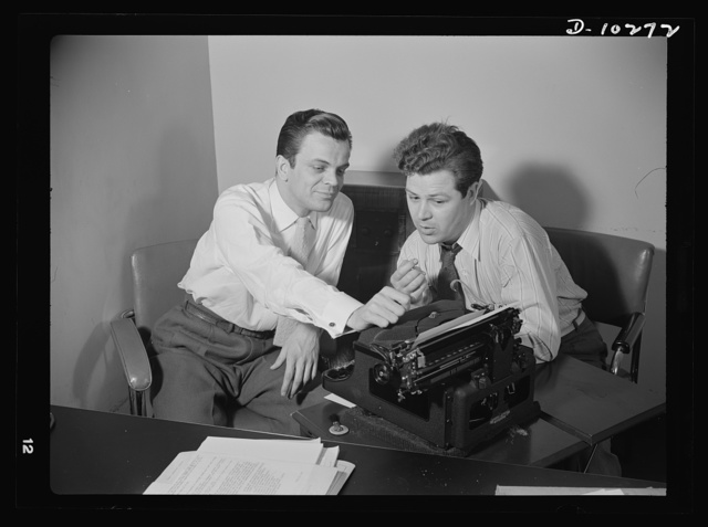 """""""You Can't Do Business With Hitler,"""" a series of radio shows, written and produced by the radio section of the Office of War Information (OWI), is transcribed four times a month. Elwood Hoffman (left) writes the scripts, and Frank Telford directs the production"""