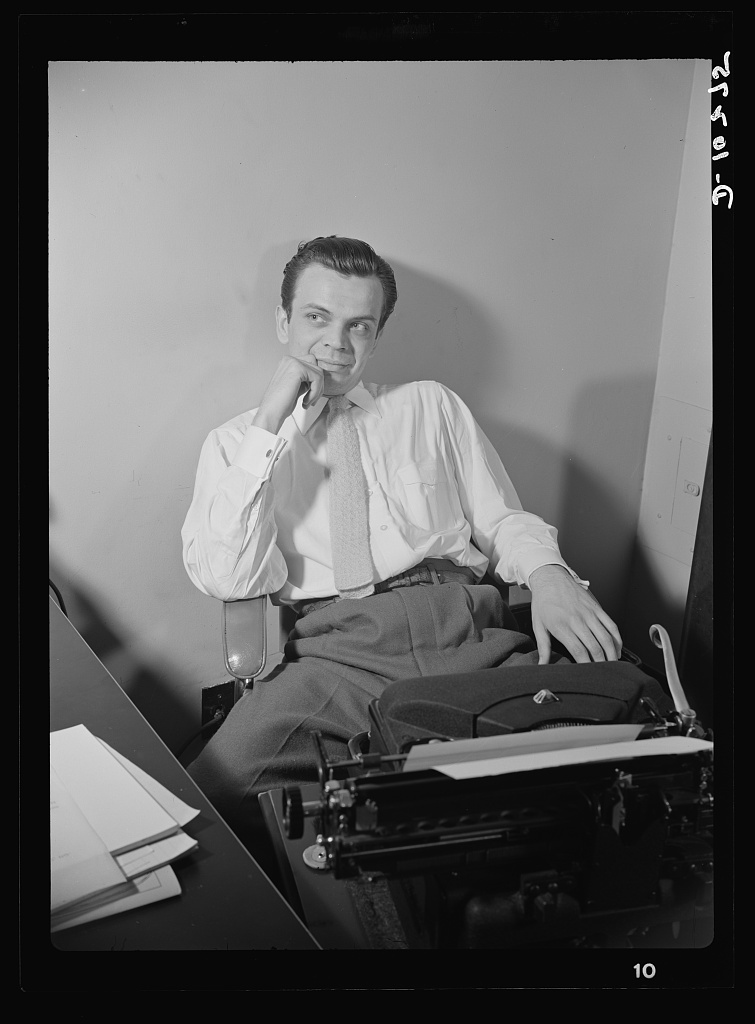 """""""You Can't Do Business With Hitler."""" Elwood Hoffman writes the script for """"You Can't Do Business With Hitler,"""" transcribed radio show whose distribution among radio stations in the United States has jumped from 300 when it was inaugurated in January, t1942. The programs are written by the radio section of the Office of War Information (OWI)"""