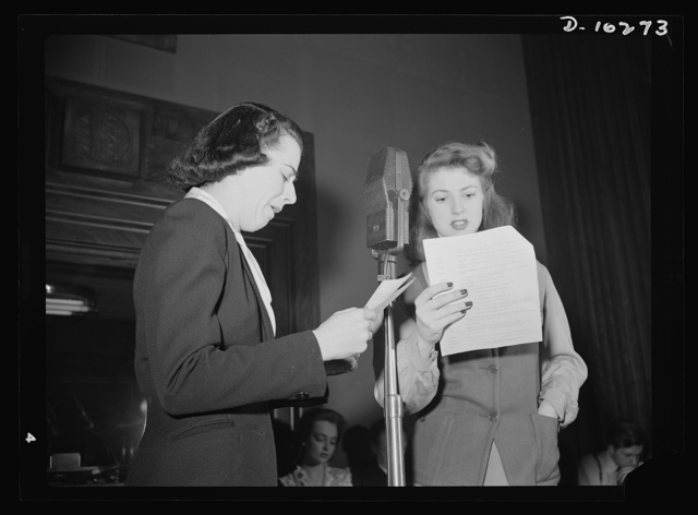 """""""You Can't Do Business With Hitler."""" Ilona Killian (left) and Virginia Moore are members of the cast of """"You Can't Do Business With Hitler"""" radio show, written and produced by the radio section of the Office of War Information (OWI). This series of programs is broadcast by more than 790 radio stations throughout the country"""
