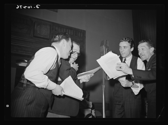 """You Can't Do Business With Hitler."" Rehearsing for the radio show ""You Can't Do Business With Hitler"" are (left to right) Abrasha Rbofsky, Colonel Charles Ferris, John Flynn, and Robert Pollard. This series of programs are written and produced by the radio section of the Office of War Information (OWI)"