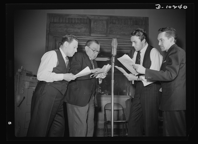 """""""You Can't Do Business With Hitler."""" Rehearsing for the radio show """"You Can't Do Business With Hitler"""" are (left to right) Abrasha Robofsky, Colonel Charles Ferris, John Flynn, and Robert Pollard. This series of programs is written and produced by the radio section of the Office of War Information (OWI)"""