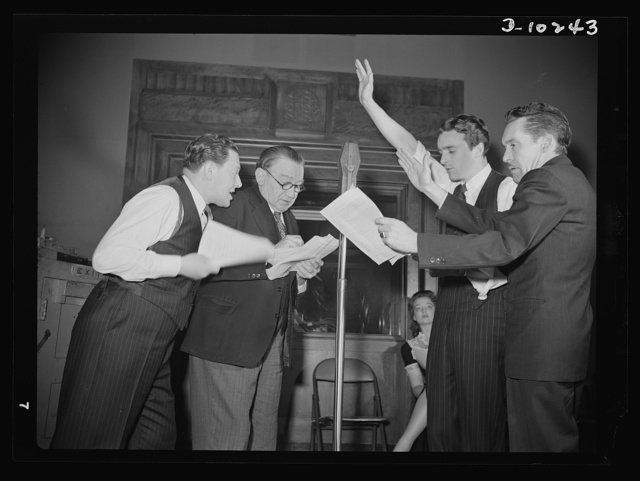 """You Can't Do Business With Hitler."" Rehearsing for the radio show ""You Can't Do Business With Hitler"" are (left to right) Abrasha Robofsky, Colonel Charles Ferris, John Flynn, and Robert Pollard. This series of programs is written and produced by the Office of War Information (OWI)"