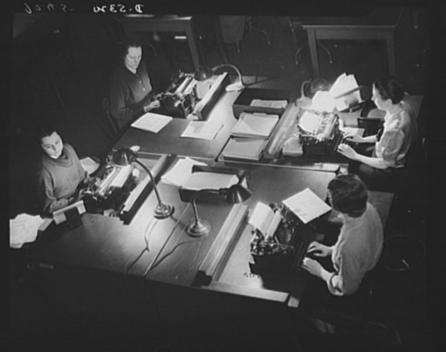 Young women on the nation's myriad filing lines, plow their efficient way through the miles of additional clerical work which the war has brought to government agencies in Washington and throughout the United States of America
