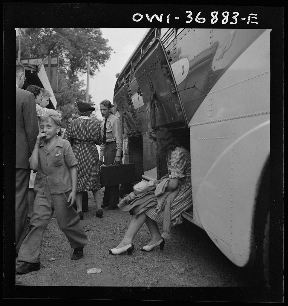 A Bus Driver Removing The Baggage From A Greyhound Bus That Broke Down Between Washington D C