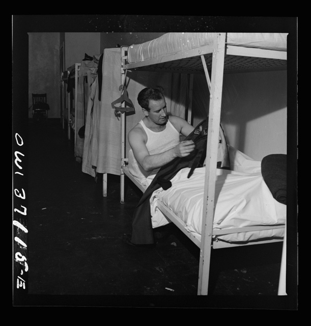 A Greyhound bus driver dressing in the dormitory at the garage. This is for the use of drivers living in another town but have their layover time in Pittsburgh