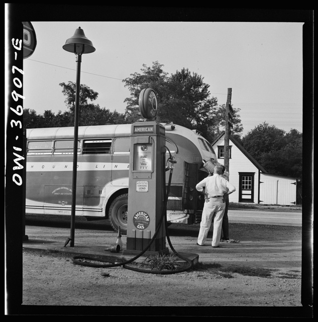 A Greyhound bus that has been stopped at a filling station to get water between Washington, D.C. and Pittsburgh, Pennsylvania