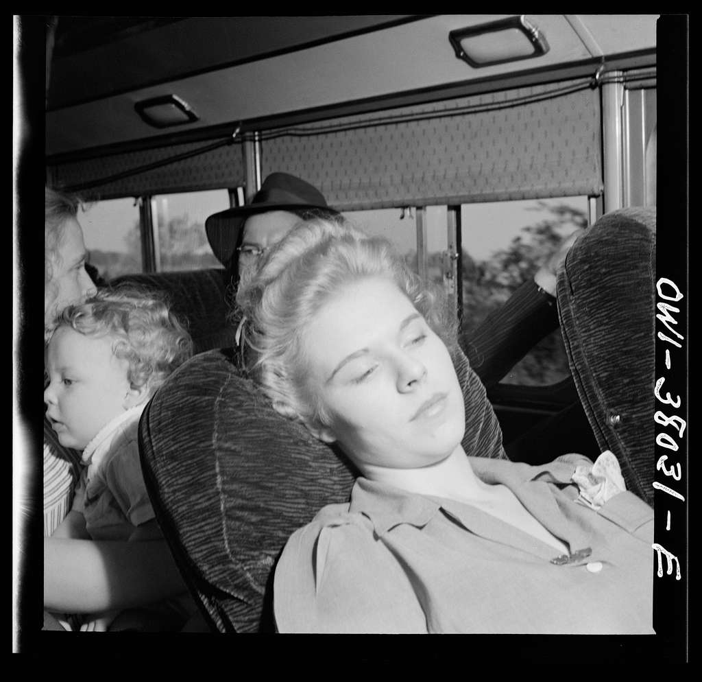 A Greyhound bus trip from Louisville, Kentucky, to Memphis, Tenness, and the terminals. Passenger on Louisville-Nashville bus. She is on her way to be married