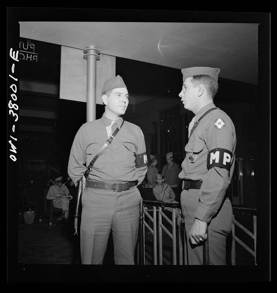 A Greyhound bus trip from Louisville, Kentucky, to Memphis, Tennessee, and the terminals. M.P. (Military Police) on duty at the bus station at Memphis, Tennessee