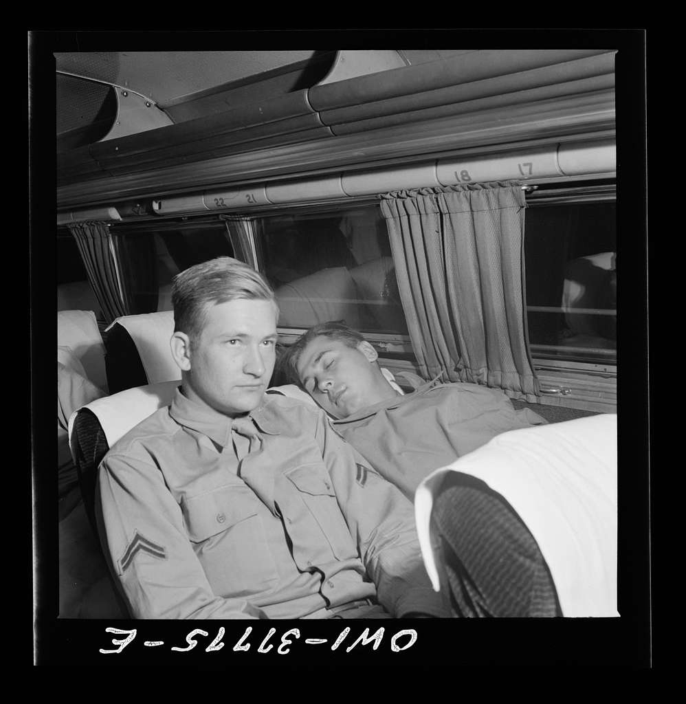 A soldier sleeping on the way from Cincinnati, Ohio to Louisville, Kentucky on a Greyhound bus