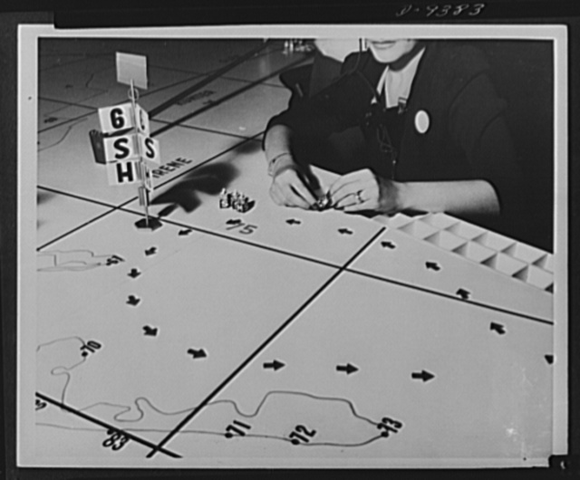"Aircraft warning service. At the filter center, each of the girl plotters is in charge of a section of the map. She receives all messages from spotters in her area and places a marker, called a ""pip"" on the spot where the plane has been observed. The pip is moved on at each new report, leaving a trail of arrows across the map to show the plane's direction. After a plane has been reported three times the pip is removed and replaced by a standard"