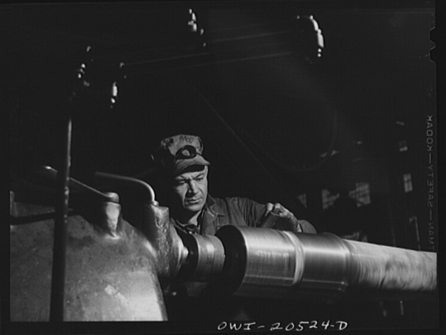 Albuquerque, New Mexico. Machinist George Mainz, working at an axle lathe in the Atchison, Topeka and Santa Fe Railroad shops
