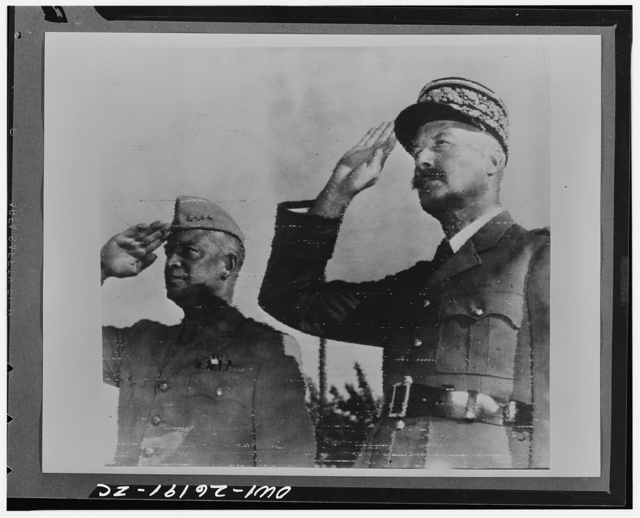 Algiers, Algeria. General Dwight D. Eisenhower, commander in chief of Allied Armies in North Africa, and General Honore Giraud, commanding the French forces, saluting the flags of both nations at Allied headquarters