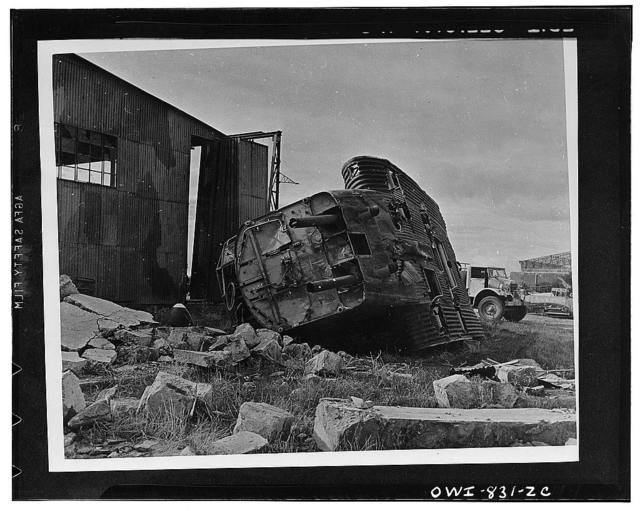 All that is left of a Junkers 52 troop carrier after Allied airmen bombed the administrative buildng and airdrome of an Axis position in Libya