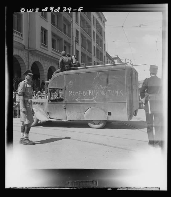 """Allied vehicle carrying the inscription, """"Rome and Berlin via Tunis"""""""
