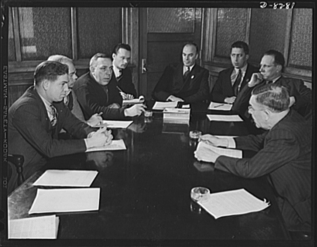 American Locomotive labor-management committee. Labor-management committee meeting at American Locomotive Company, Schenectady, New York. Left to right, C. Hallenback (labor), F. Hughes (labor), J. Smith (labor), W.A. Pettigrew (stenographer), D.W. Cameron (chairman of committee), G. Mabee (management), L.C. Blackburn (management), J.W. Biggerstaff (management)