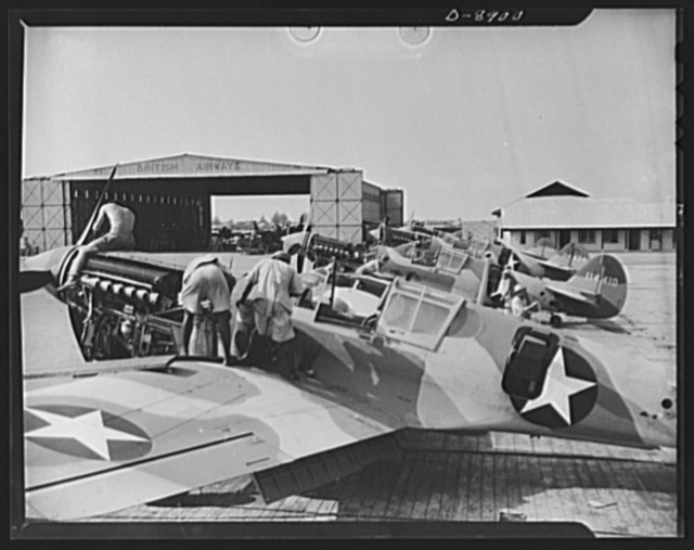 """American """"steam chickens"""" arrive in Africa. As rapidly as they are assembled, American P-40 fighter planes line up at an African airport, are fueled and given final adjustments prior to taking off for the battlefront"""