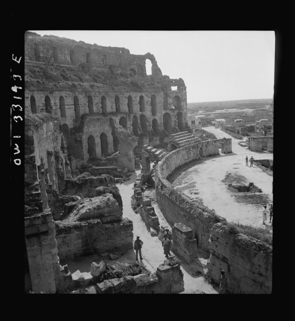 American troops of the 57th Fighter Group sightseeing among Roman ruins in Tunisia