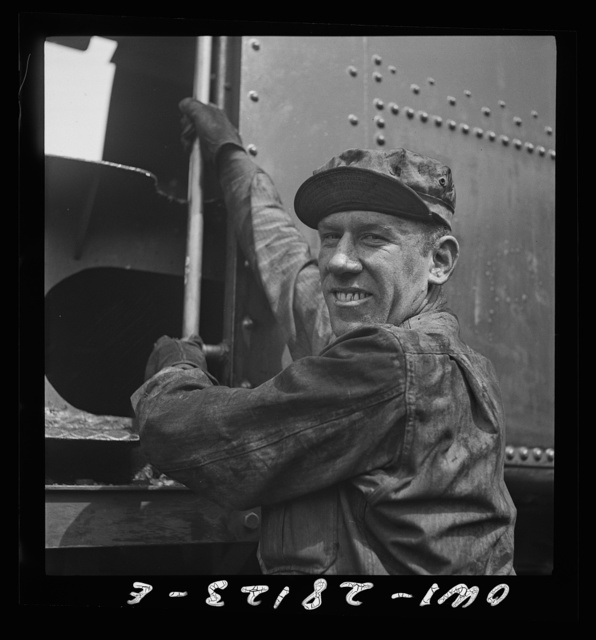 An American soldier engineer climbing into the cab of his train. An engineer in private life, he is happy at the chance to push supplies in the aid to Russia drive. Somewhere in Iran