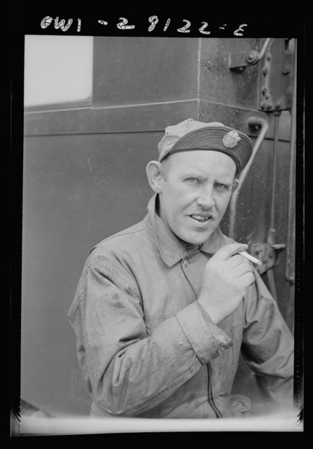 An American soldier trainman has the insignia of the United States Army on the visor of his cap. He is somewhere in Iran