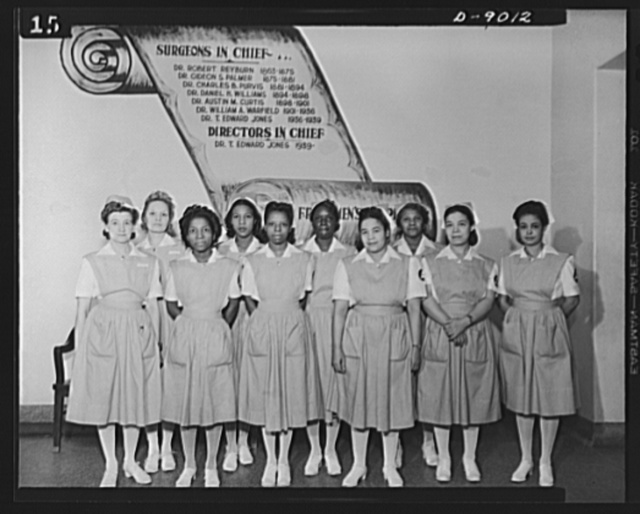 Answering call for volunteer nurses aides. Part of the class of senior volunteer nurses aides of Freedmen's Hospital, Washington, D.C.  They received their caps and pins on December 9, 1942, in the first class to graduate from this hospital. First row, left to right: Mr. Gertrude Stone, assistant captain, Mrs. Lynwood Cundiff, Miss Doris Stevenson, Mrs. Arthur Randall, Mrs. Martin Beleno, Mrs. Robert Ming; Second row: Mrs. George M. Johnson, captain, Miss Susie Freeman, Miss Florence Grant and Mrs. Louis Lucas