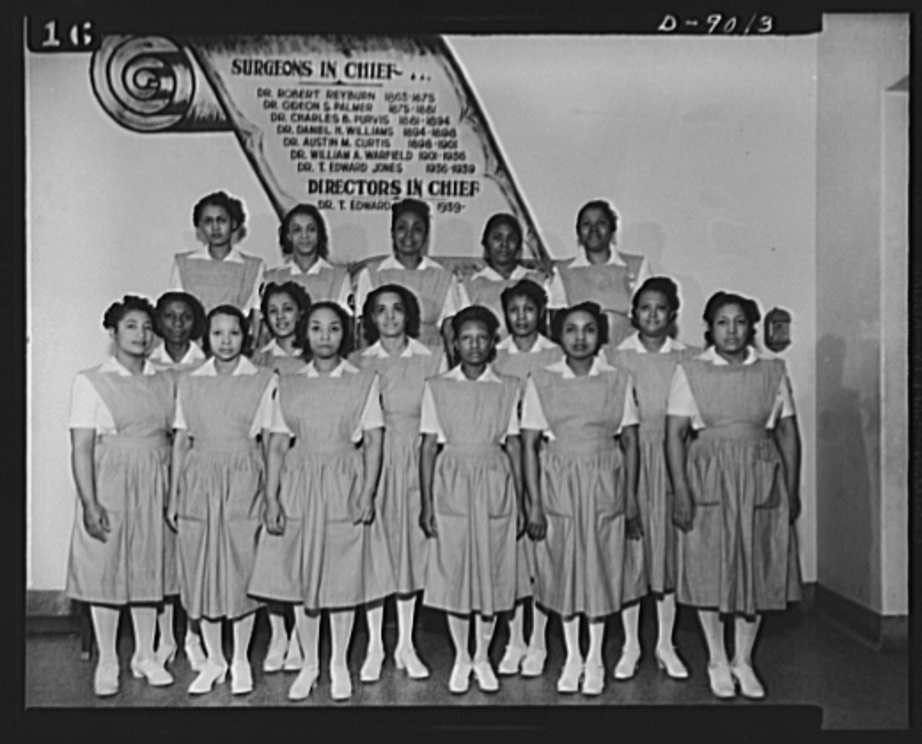 """Answering call for volunteer nurses aides. Part of the """"uncapped"""" class taking the volunteer nurses aides course at Freedmen's Hospital, Washington, D.C.  First row, left to right: Mrs. Dora Boston, Mrs. Mattie Sparkman, Mrs. John Gill, Mrs. Mary Garrigher, Mrs. Thomas Couch and Mrs. Ethel Washington; Second row: Mrs. Samontha Dawkins, Mrs. Maxine Jackson, Mrs. Hattie Lipscomb, Mrs. Zelhonia Applewhite and Mrs. Mary F. Anderson; Third row: Miss Romay Johnson, Mrs. Mary Hobson, Mrs. Estelle Cloggette, Mrs. Edna Janifer and Mrs. Ruby Lee Bates"""