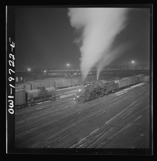 Argentine, Kansas. Freight train about to leave the Atchison, Topeka, and Santa Fe Railroad yard for the west coast