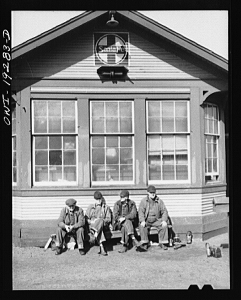 Argentine, near Kansas City, Kansas. Atchison, Topeka and Santa Fe Railroad switchmen waiting outside the yard office for the shift to change. They go on at 3:30 p.m.