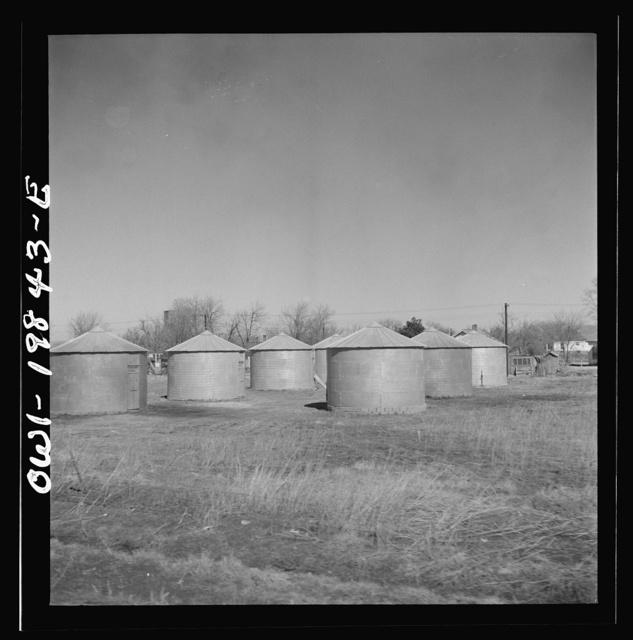 Argonis, Kansas. Wheat storage bins on the Atchison, Topeka and Santa Fe Railroad between Wellington, Kansas and Waynoka, Oklahoma