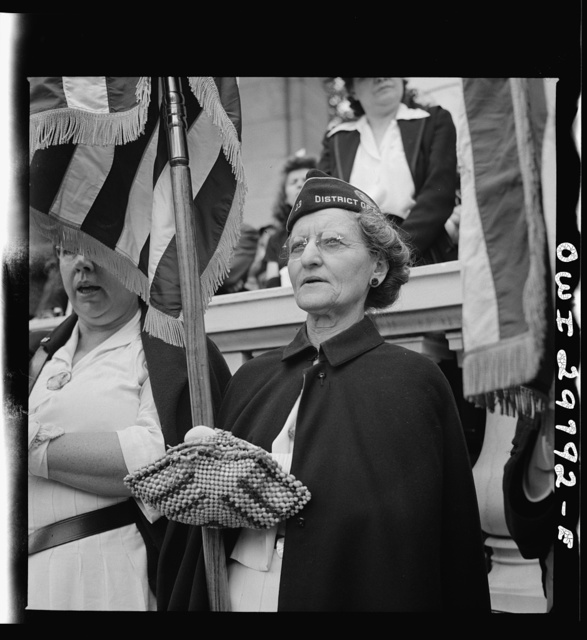 """Arlington Cemetery, Arlington, Virginia. American Legion color bearer during the singing of """"America"""" at the Memorial Day services in the amphitheater"""
