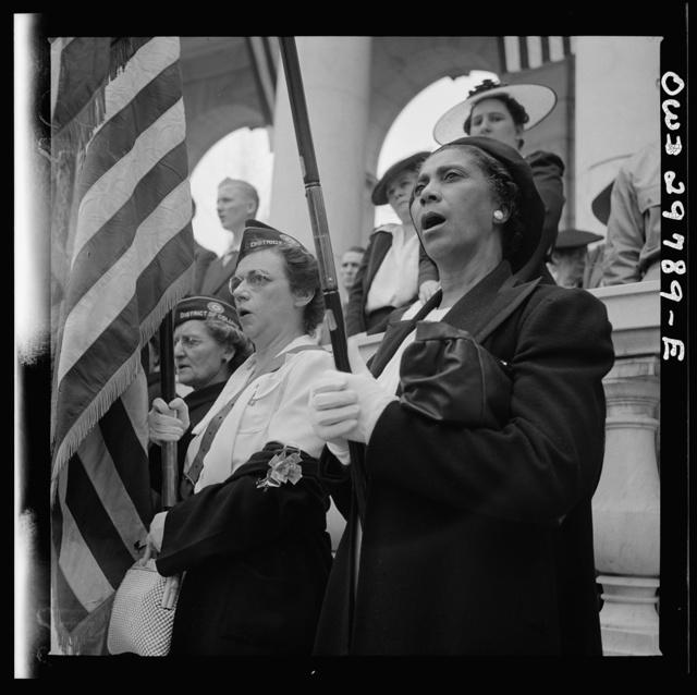 "Arlington Cemetery, Arlington, Virginia. An American Legion color bearer singing ""America"" in the amphitheater"