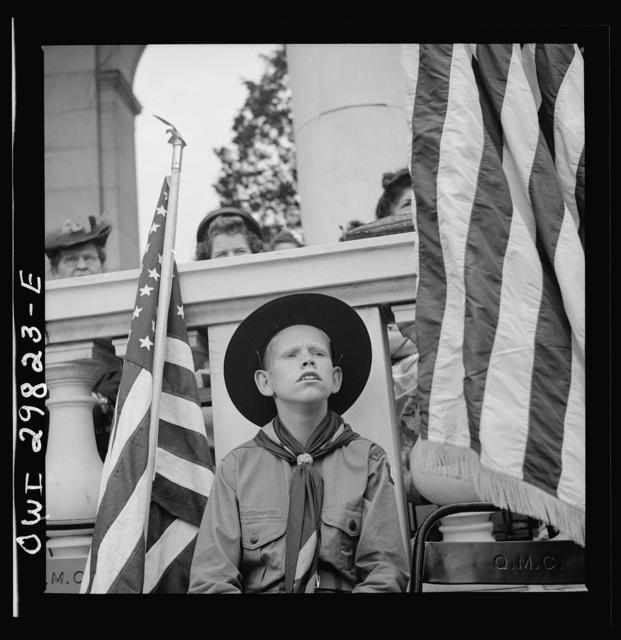 Arlington Cemetery, Arlington, Virginia. Boy scout color bearer listening to the Memorial Day ceremony