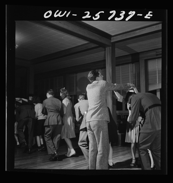 """Arlington, Virginia. Dancing the Virginia reel at a bi-weekly Saturday night """"open house"""" dance at Idaho Hall, Arlington Farms, a residence for women who work for the government for the duration of the war"""