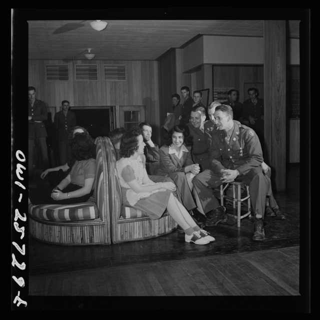 "Arlington, Virginia. During intermission at one of the bi-weekly ""open house"" dances held in the main lounge of Idaho Hall, Arlington Farms, a residence for women who work in the government for the duration of the war"
