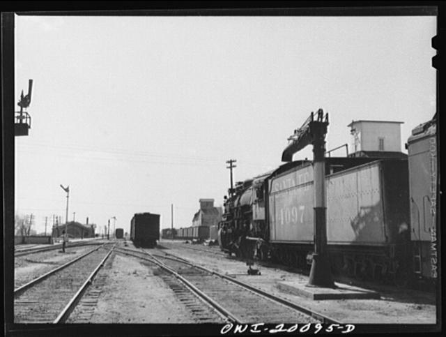 Atchison, Topeka and Santa Fe engine stopping for water enroute to Waynoka, Oklahoma