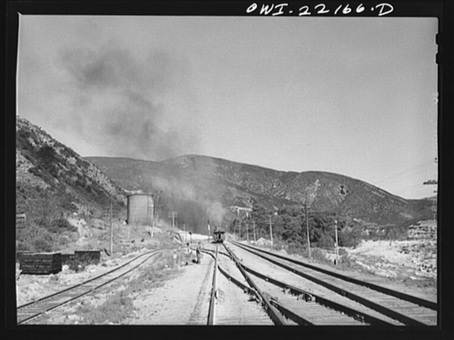 Atchison, Topeka, and Santa Fe Railroad helper engine stopping for water near Cajon, California during the climb from San Bernardino to Summit